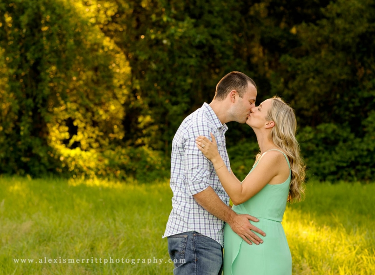 Pregnancy couple kissing | Mill Creek Maternity Photographer