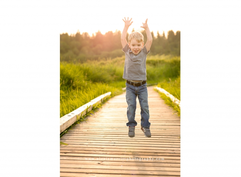 Boy jumping on boardwalk | Seattle Child Photographer