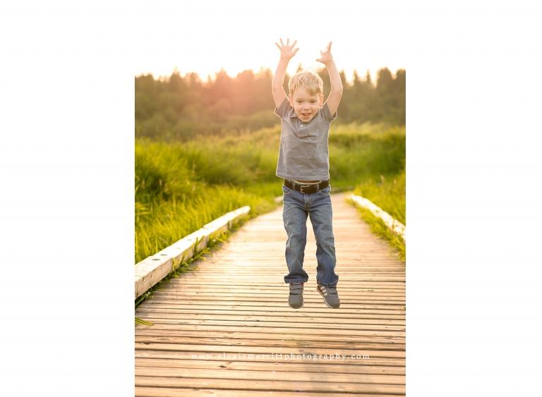 Boy jumping on boardwalk | Seattle Child Photographer