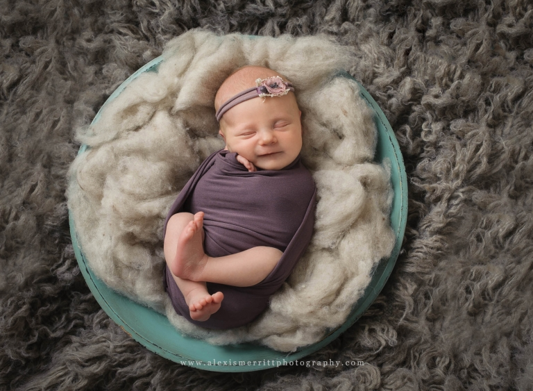 Wrapped baby in a blue bowl   Bothell Newborn Photographer