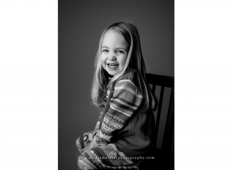 Girl smiling in chair | Bothell family photographer