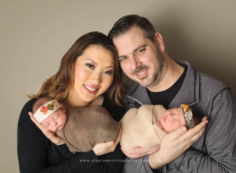 Mom and Dad with babies in studio | Seattle newborn twin photographer
