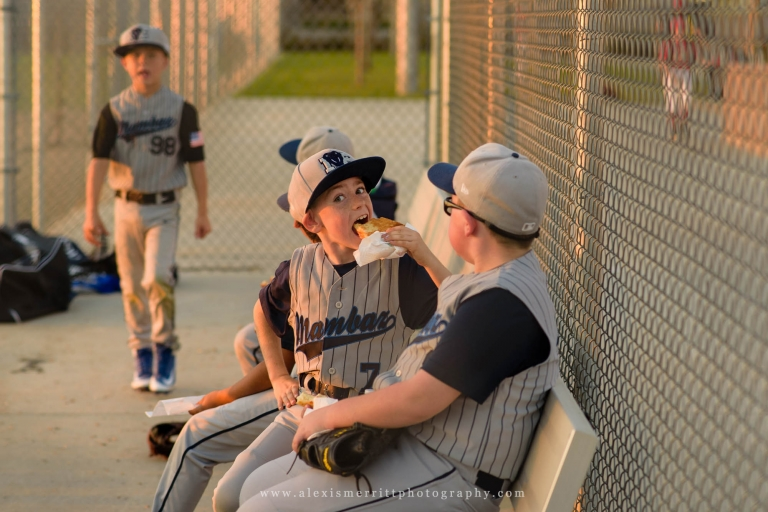 Boy eating in baseball dugout | Seattle Photographer