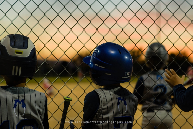 Boy watching baseball game at sunset | Seattle Photographer