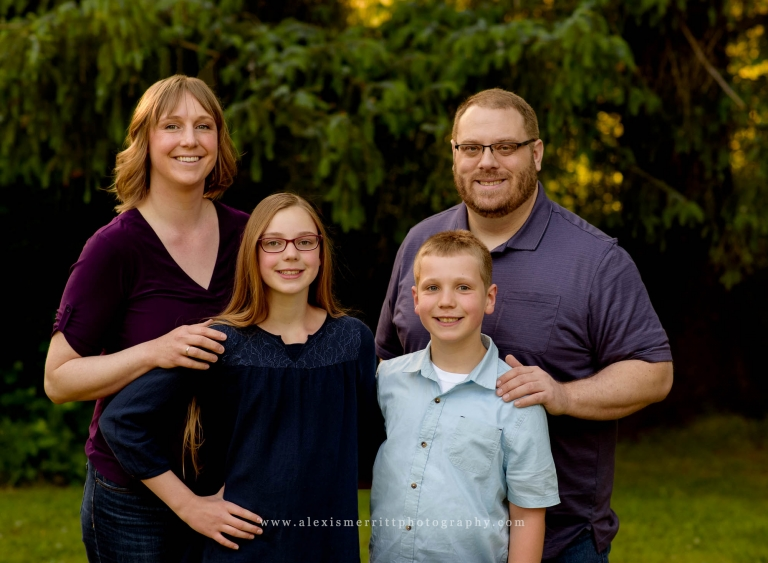 Family smiling at North Creek Park | Seattle Photographer