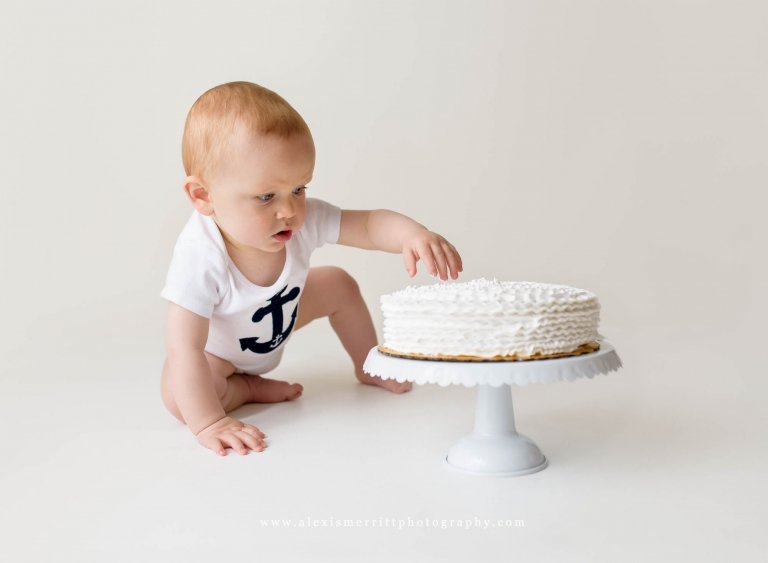 Baby eating cake | Bothell studio photographer