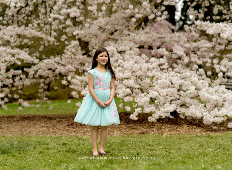 Girl standing in front of cherry blossoms UW Arboretum | Seattle Family Photographer
