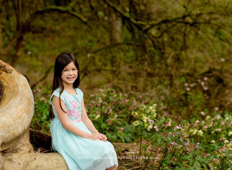 Girl sitting on log UW Arboretum | Lynnwood Family Photographer