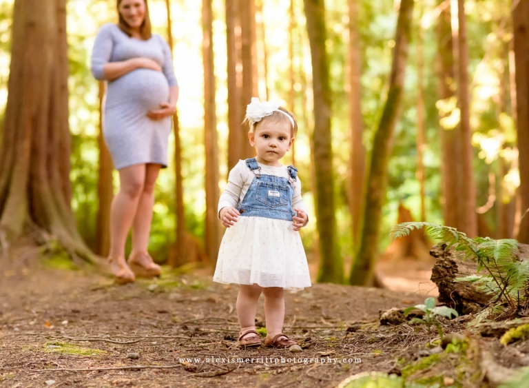 Little girl in foreground, Pregnancy Mom in background - McCollum Park | Maternity Photographer Seattle